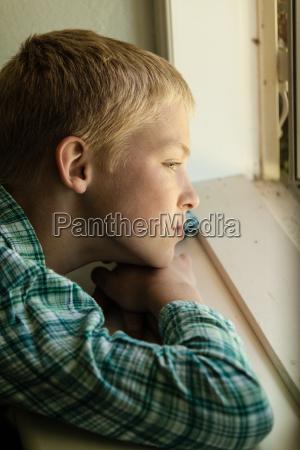 child with sad expression sitting near