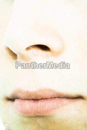 young mans nose and mouth extreme