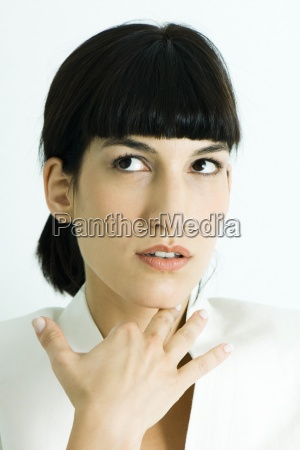 woman holding hand under chin looking