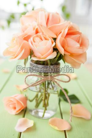fresh roses in jar