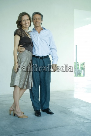 mature couple standing together mans arm