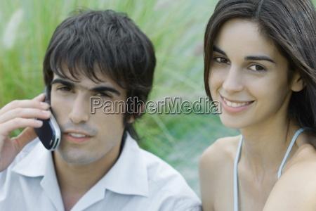 young couple woman looking at camera
