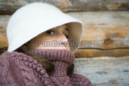 teenage girl wearing hat and turtleneck