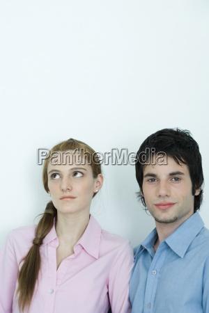 young couple man looking at camera