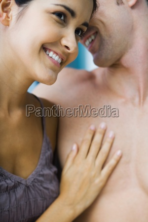 couple nuzzling womans hand on mans