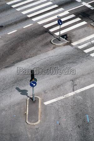 crosswalk and traffic arrows high angle