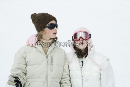 teen girls dressed in ski gear