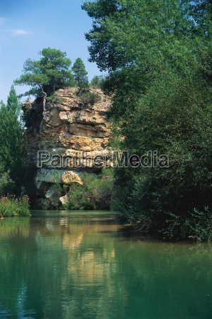 verdant waterscape with crag