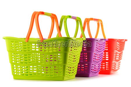 three empty plastic shopping baskets isolated