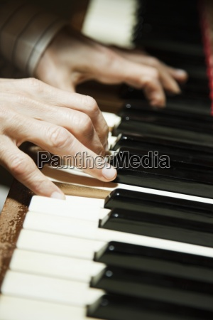 playing piano close up