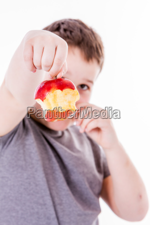 little boy with food isolated on