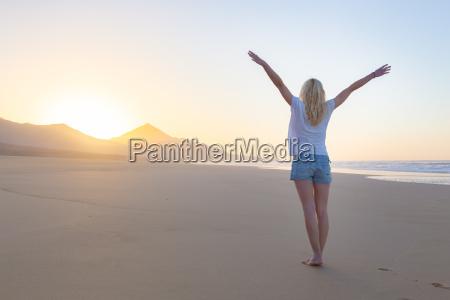 free woman enjoying freedom on beach