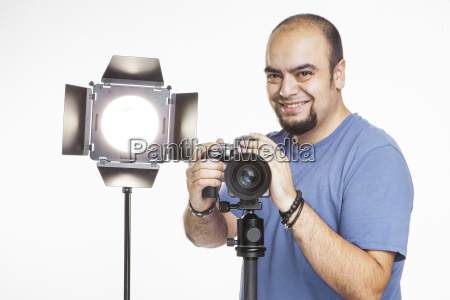 professional photographer with photographic equipment