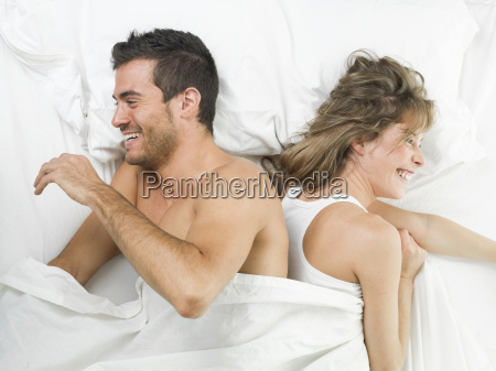 attractive couple in love laughing on