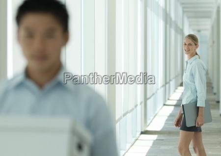 female office worker in corridor looking