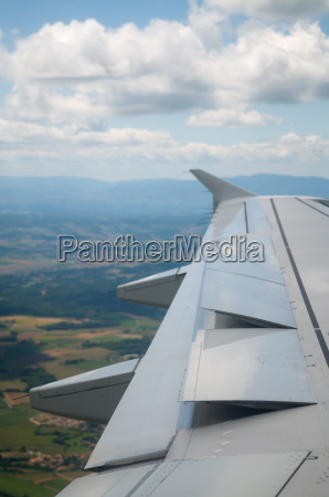 wing of airplane going to land
