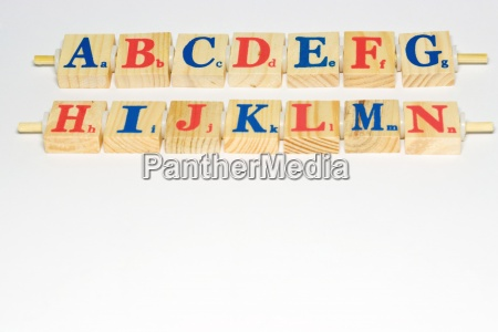 wooden alphabet blocks lined up close