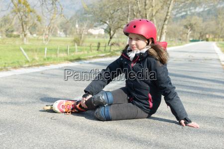 young attractive teenage skater grimacing in