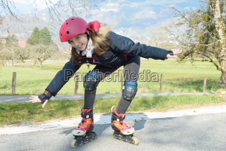 pretty preteen girl on roller skates