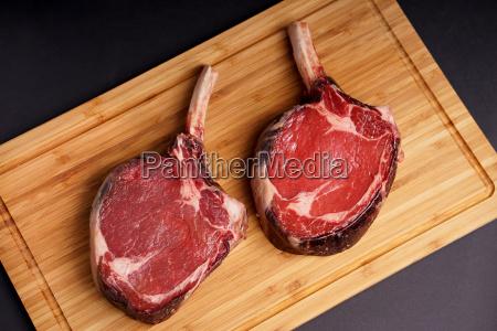 tomahawk steak on wood board