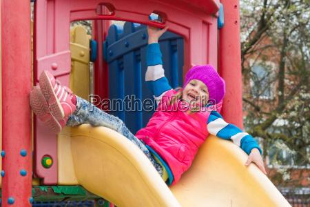five year girl sitting on top