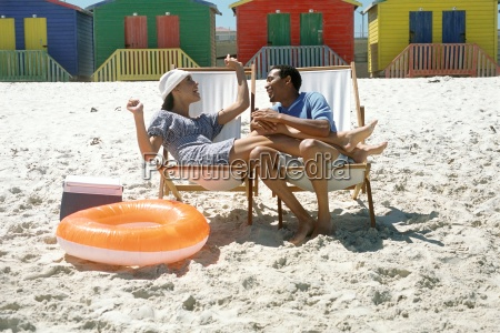 couple sitting in lounge chairs at