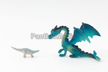 toy dinosaur and toy dragon face