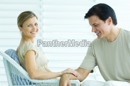 couple sitting on porch woman touching