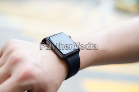 man using wearable smart watch