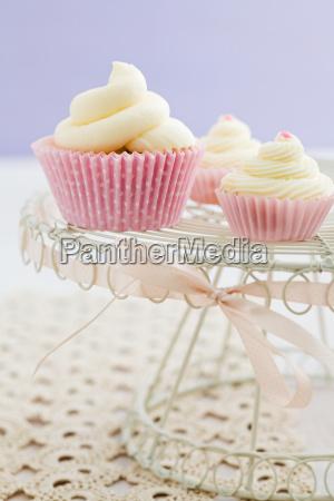 three vanilla cupcakes