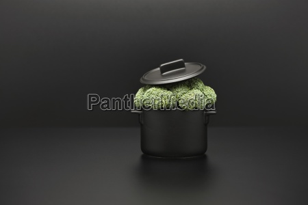 food concept fresh broccoli overflowing pot