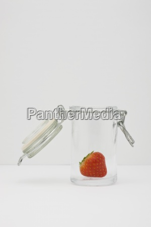 food concept single fresh strawberry in