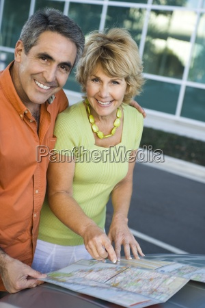 mature couple looking at map together