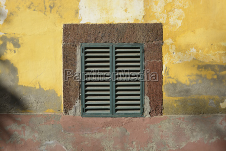 shutters in weathered wall funchal madeira