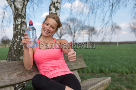 jogger is sitting on the bench