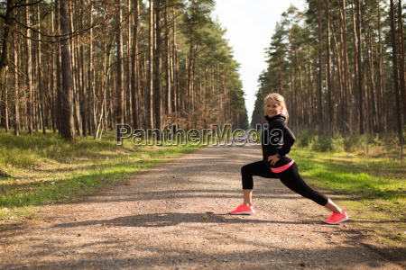 jogger doing stretching exercises on a