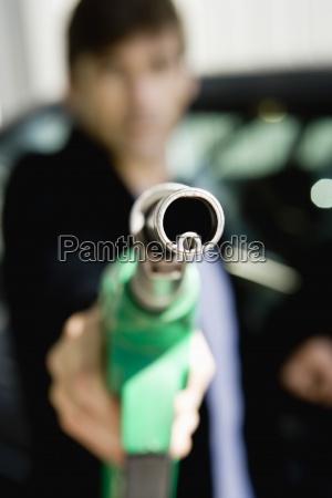 end of gas pump hose nozzle