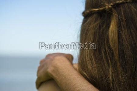 couple mans arm around womans shoulder