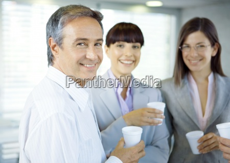 business colleagues standing in office with