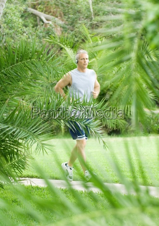 mature man jogging on walkway