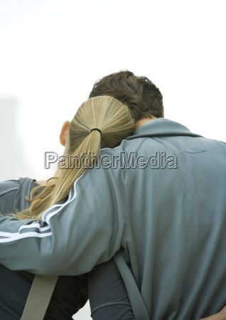 young couple womans head on mans