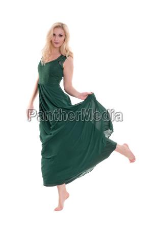 beautiful blond woman in long green