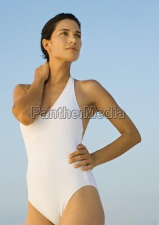 woman in swimsuit standing looking away