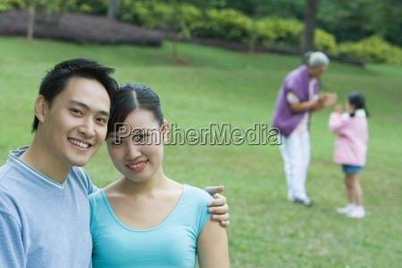 couple smiling at camera senior woman