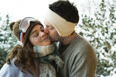 young couple in winter clothing man