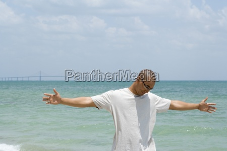 man standing at the beach with