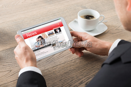 close up of businessman reading news