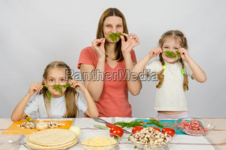young housewife with two daughters having
