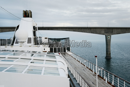 large cruise ship passing under the