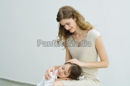 little boy resting head on mothers
